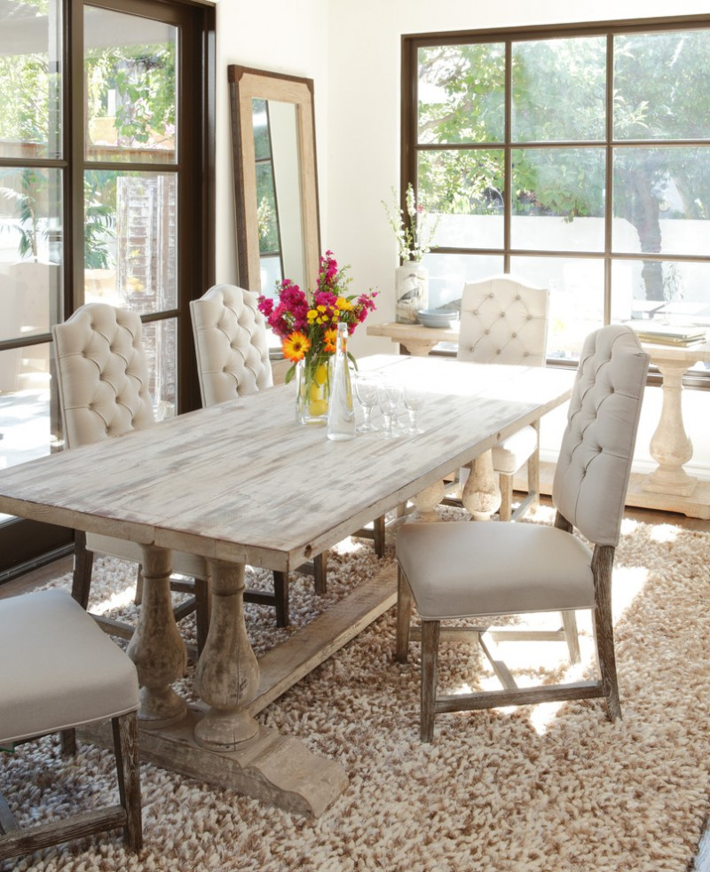 rustic dining room with dominant neutral schemes whitewashed dining table white dining chairs area rug with light brown details