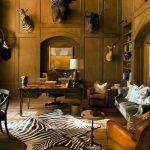 Rustic Home Office Dark Hardwood Floors Dark Hardwood Walls With Animal Head Ornaments Dark Hardwood Desk Dark Brown Armchairs Grey Couch