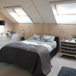 Scandinavian Style Bedroom Idea Heardboard Less Bed Frame In Black Grey White Bedding Treatment Pale Toned Woodboard Floors Woodboard Walls Slanted Ceilings With A Pair Of Skylights