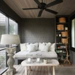 Screened Porch Idea Day Bed With White Comforter And Accent Pillows Pale Hardwood Table Pale Hardwood Wood Board Floors Bold Grey Tiles Walls Stand Lamp With Hardwood Base And White Shade