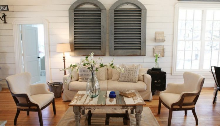 shabby and chic living room idea shabby center table shabby but cool window shutters white sofa slipcover a pair of white chairs medium toned wood floors white siding walls