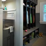 small mudroom ideas black wooden cabinet storage above and bellow the hook rack doormat shoe storage sink and faucet nice lighting