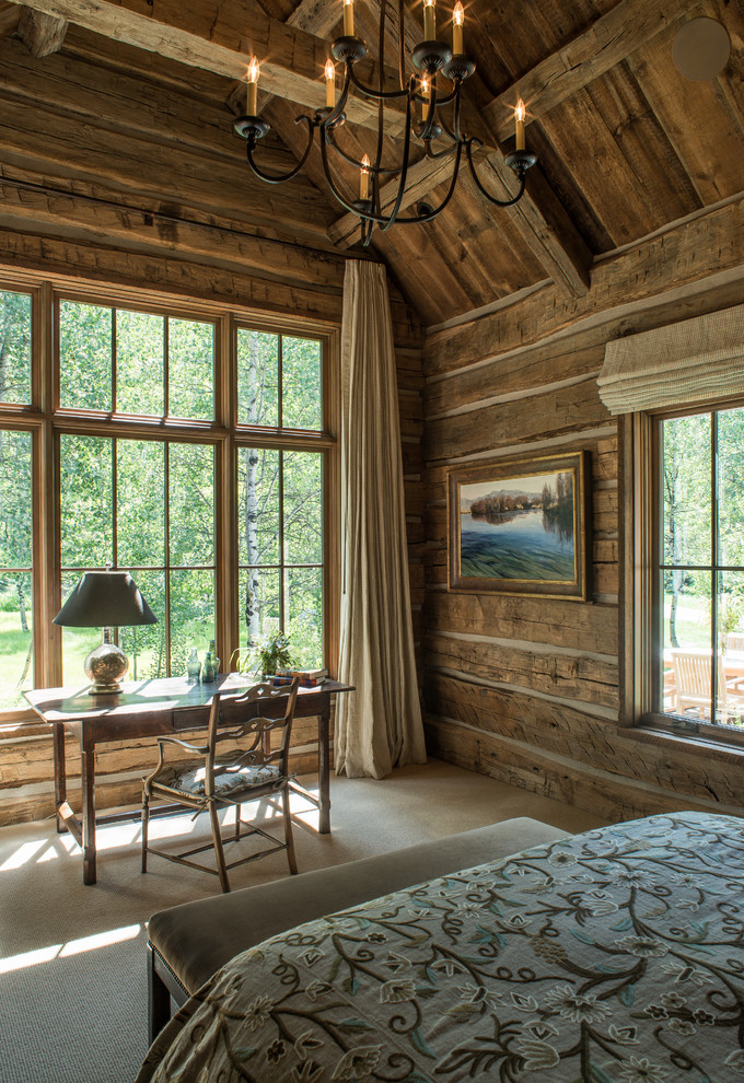 small rustic cabins bedroom bed desk chair big windows chandelier painting curtain lamp nice view