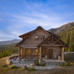 small rustic cabins chairs outdoor areas trees sky beautiful scenery pillars windows door wooden parts