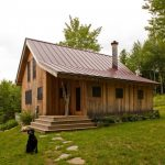 small rustic cabins grass trees windows wooden walls door stairs roof beautiful exterior