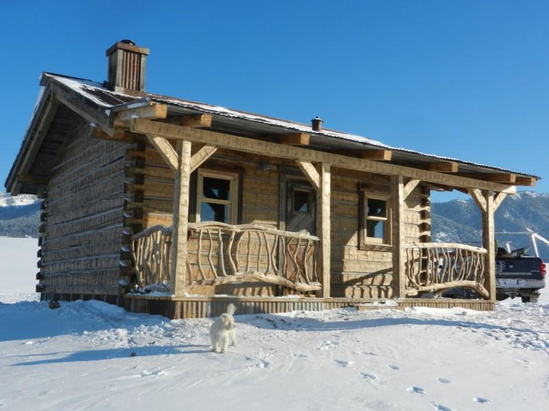 small rustic cabins railing pillar windows door wooden parts vehicle beautiful location cool exterior