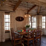 Small Rustic Cabins Table Chairs Curtains Wood Floor Windows Chandelier Flowers Wall Decor Dining Room
