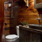 small rustic cabins toilet towels shower vanity wooden wall cool lamp shelf beautiful bathroom