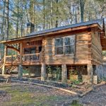 Small Rustic Cabins Trees Stairs Windows Railing Wooden Parts Stone Grass Plants Beautiful Exterior