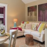 Small Sectional In White Multicolored Accent Pillows Tree Trunk Coffee Table Beige Walls With Beautiful Wall Arts