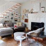 Soft & Neutral Furniture Set White Bricks Fireplace Dark Toned Wood Floors White Area Rug Light Grey Walls