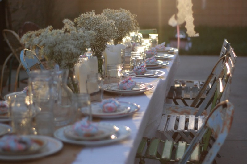 tea party decoration ideas baby breath flower with glass vase antique iron chairs white table cloth vintage tablespoon and plates