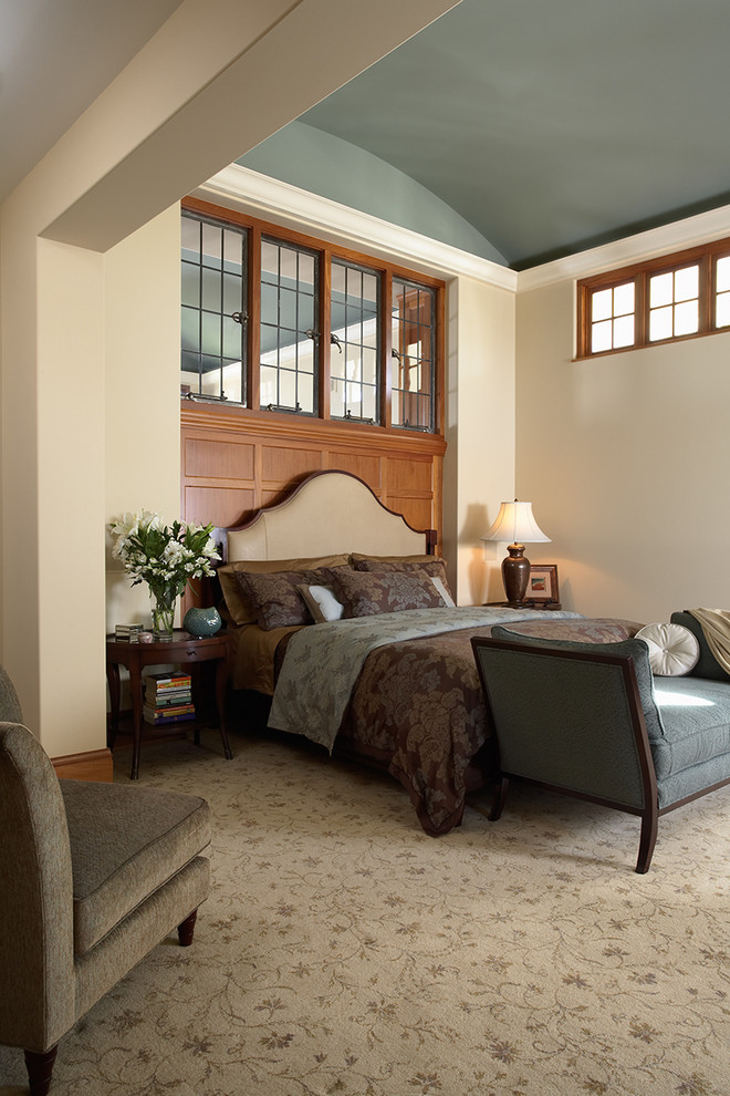 traditional bedroom furniture with curved upholstery headboard dark brown bedding treatment blue settee grey couch grey area rug with flower motifs light cream walls blue ceilings up high windows