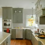 Traditional Kitchen Idea With Grey Cabinets & Grey Corner Cabinet White Paneled Fixtures White Walls & Ceilings Medium Toned Wood Floors