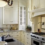 Traditional Kitchen With Glass Door Corner Cabinet In White White Kitchen Cabinets Granite Countertop Dark Top Kitchen Island With Square Sink & Faucet