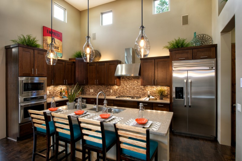 transitional kitchen with a double bowl sink, shaker cabinets, dark wood cabinets, brown backsplash, matchstick tile backsplash and stainless steel appliances