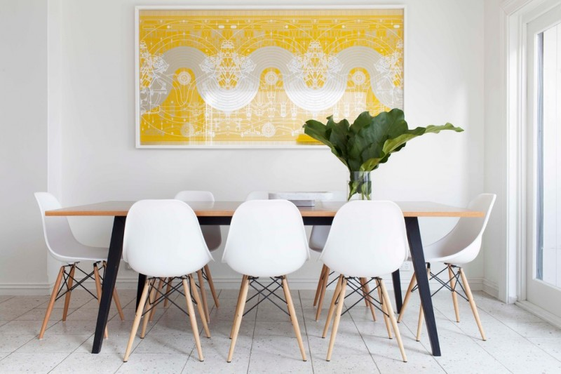 trendy and small dining room white walls white porcelain floors wood dining table without finishing modern white dining chairs with wood legs bright yellow wall art