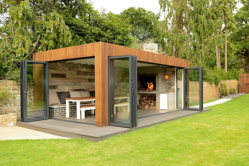 trendy7 contemporary shed for grilling and cooking glass doors with black painted wood frames hardwood exterior facade dining bench wood top dining table traditional fireplace