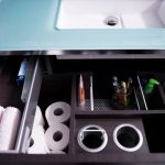 vanity organization ideas glass countertop minimalist vanity with dark wooden drawers storage deviders toiletries