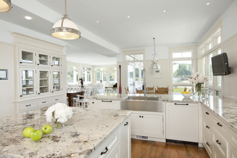 white and black granite countertop white cabinet TV pendant lights recessed lights stainles steel appliances flowering