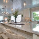 White High Kitchen Island With Marble Top With High Rattan Stools With Backs