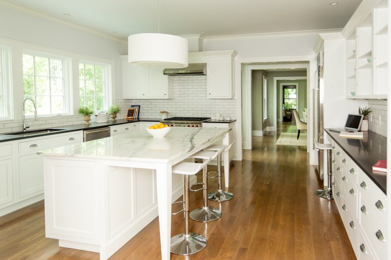 white wooden kitchen island with white marble top, white stools