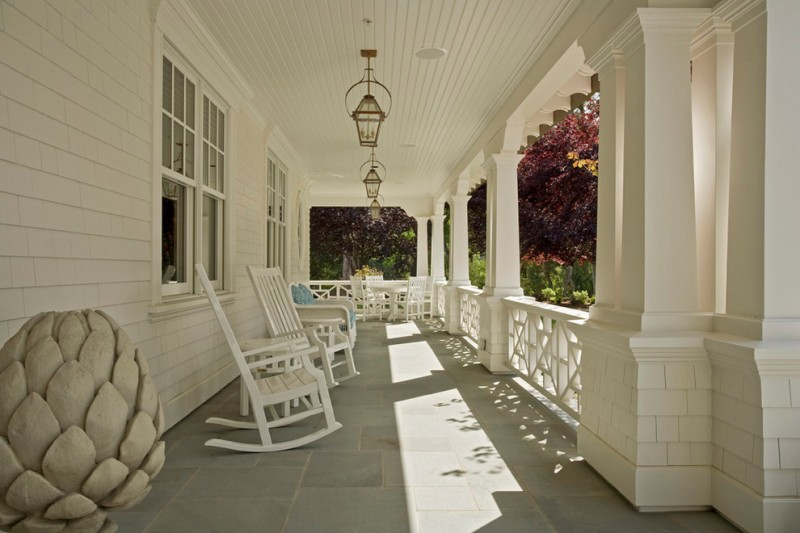 white wooden rocking chairs with white wooden table and white wooden sofa with blue cushion