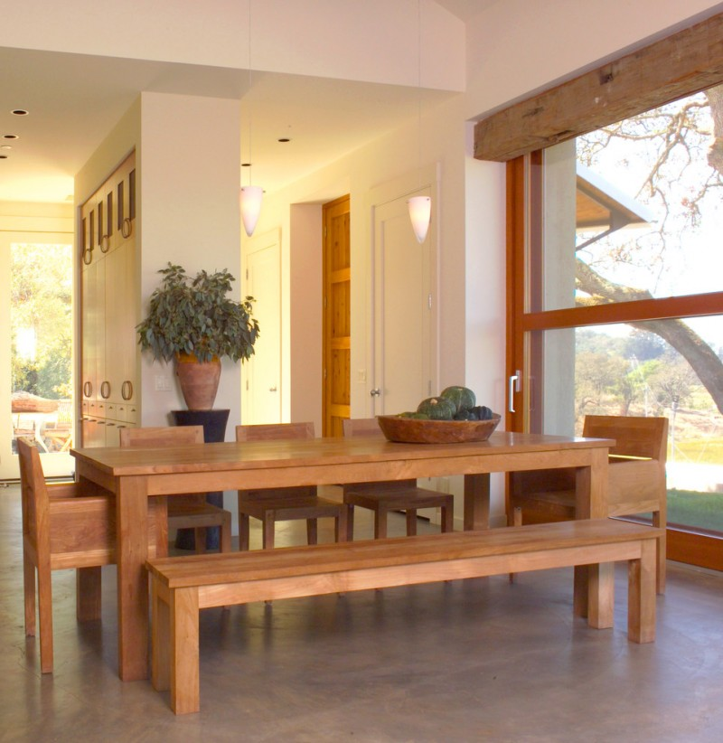 wooden rigid table with rigid chairs and bench