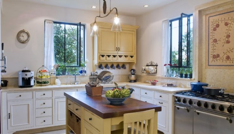 yellow wooden kitchen island with dark brown countertop and yellow wooden chairs