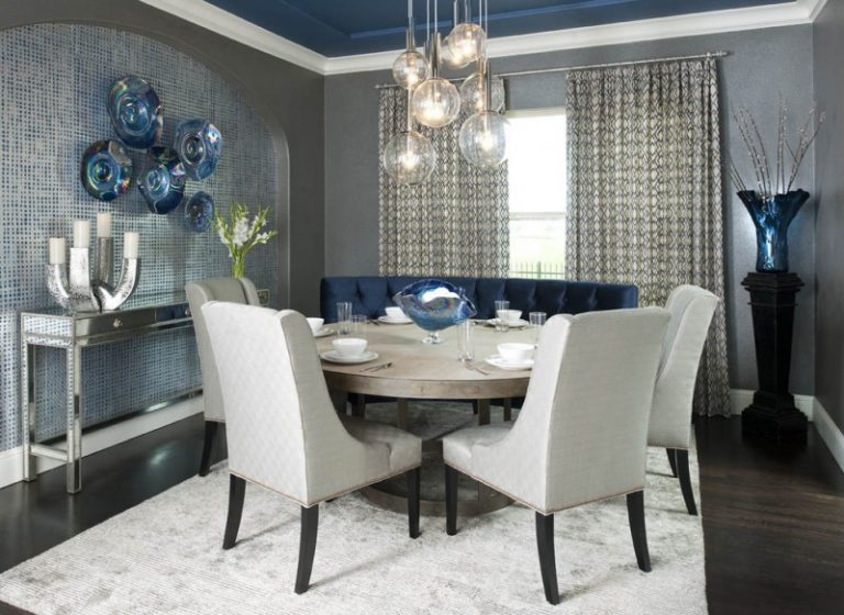 Blue Settee White Chairs Wooden Round Kitchen Table White Rug Medium Toned  Wooden Floors Chandelier Lamps