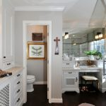 Eclectic corner shower with an under mount sink, recessed panel cabinets and white cabinets vanity in white paint medium toned wooden floors