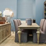 French Style Dining Room French Dining Chairs In Grey Wood Dining Table Wood Hall Table Without Finishing Blue Walls Pale Toned Wood Floors Corner Wood Storage Unit