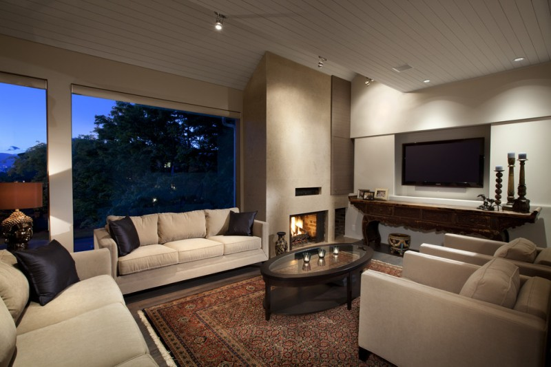 Large Trendy Living Room With A Standard Fireplace And A Wall Mounted TV  White Sofa Black
