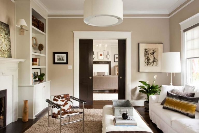 Mid Sized Contemporary Enclosed Living Room With A Library Beige Walls And Dark Hardwood Floors