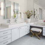 Mid Sized Contemporary Master Bathroom With A Trough Sink, Flat Panel Cabinets, White Cabinets, White Walls, Solid Surface Countertops And White Floors