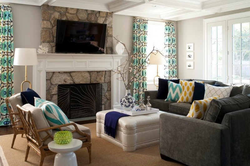Mid sized transitional formal enclosed living room with gray walls, a standard fireplace, a stone fireplace surround, a wall mounted TV, dark hardwood floors and brown floors