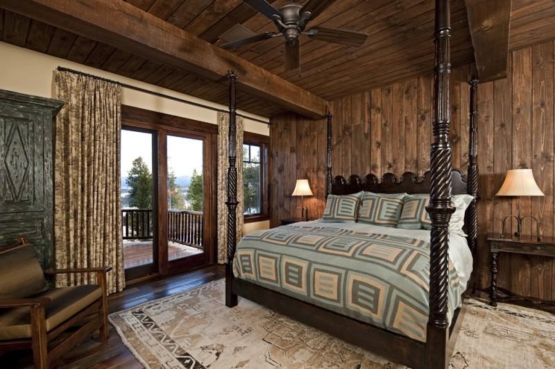 Rustic bedroom idea with beige walls and dark hardwood floors brown drapes wooden deck walls and ceiling wooden bed cream rug