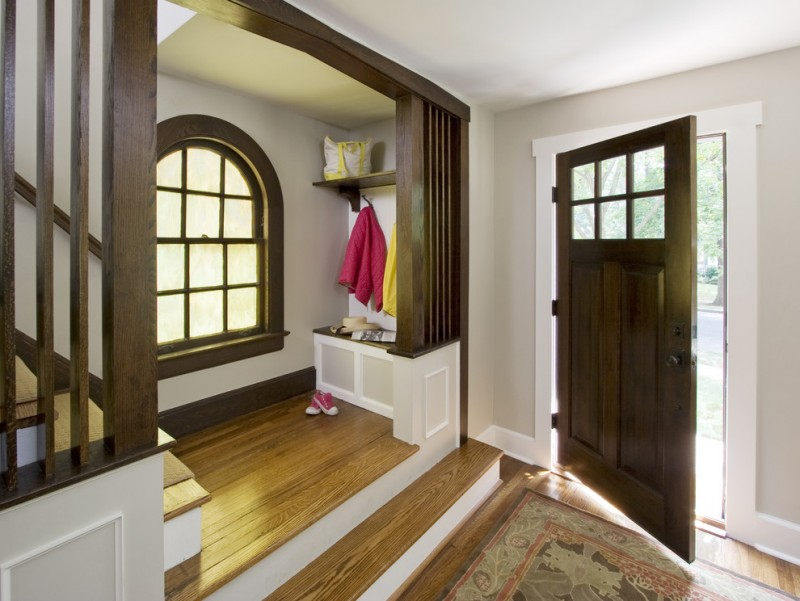 Small craftsman front door with gray walls, medium tone hardwood floors, a single front door and a medium wood front door