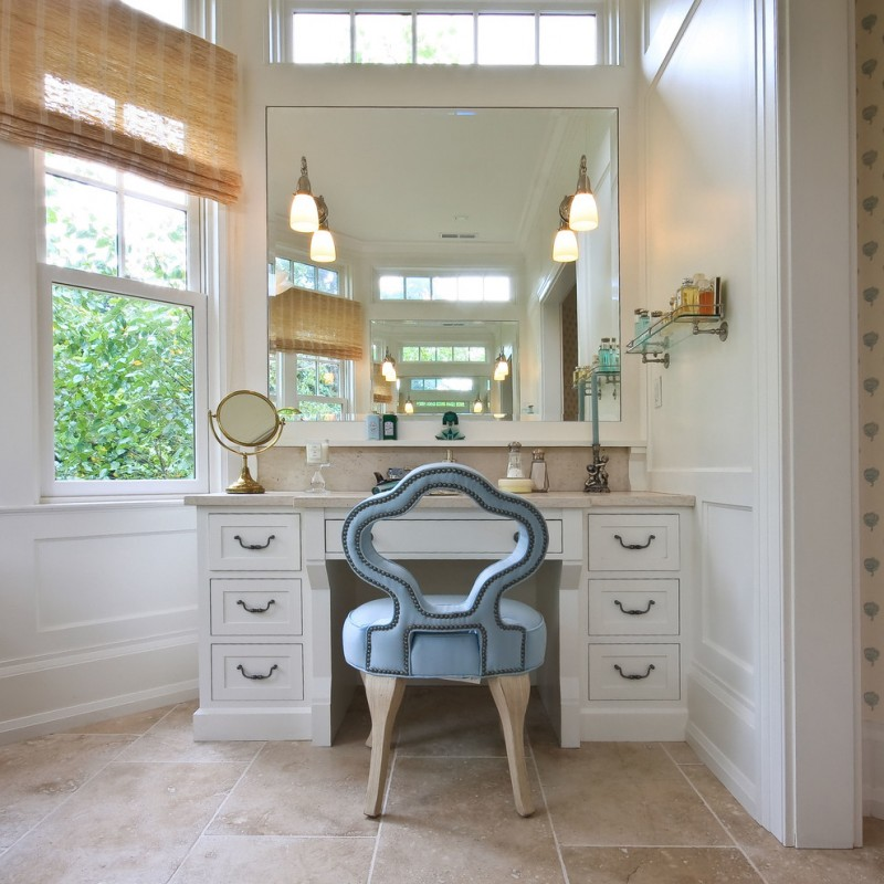 Traditional bathroom with shaker cabinets, white cabinets and white walls white chair with turquoise cushion ceramic tiles floors big rectangles mirror