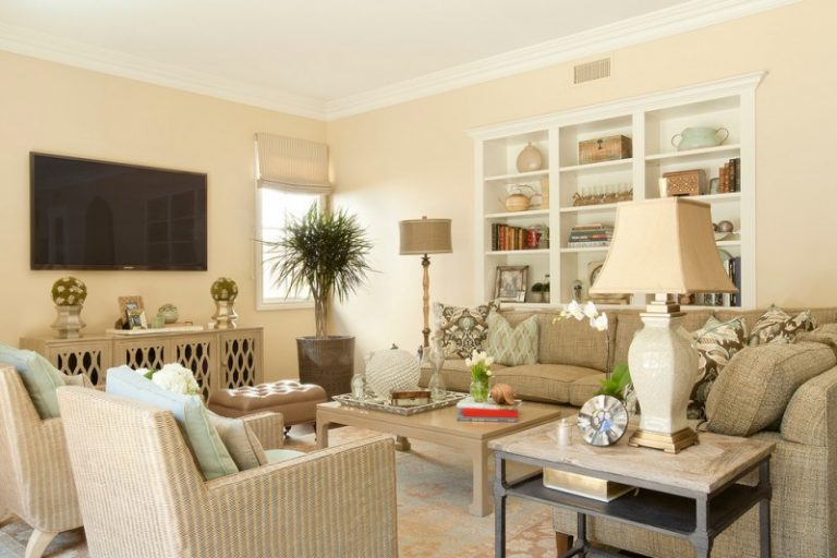 Traditional Family Room With Beige Walls And A Wall Mounted Tv White Table Lamp Standing
