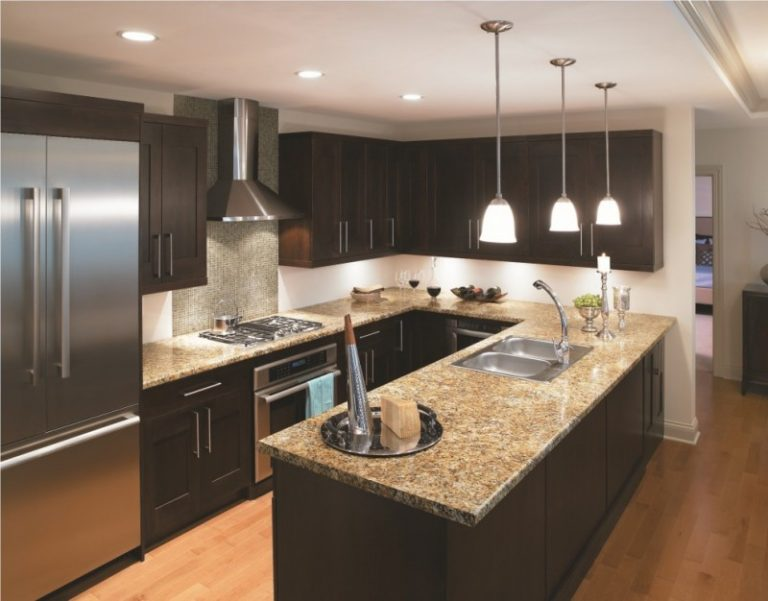 Traditional Kitchen With Dark Cabinets Light Toned Wooden Floors Black  Painted Kitchen Island Silver Appliances Pendant