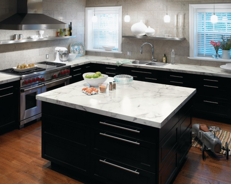 Trendy Kitchen With A Drop In Sink, Stainless Steel Appliances, Black  Cabinets And Laminate