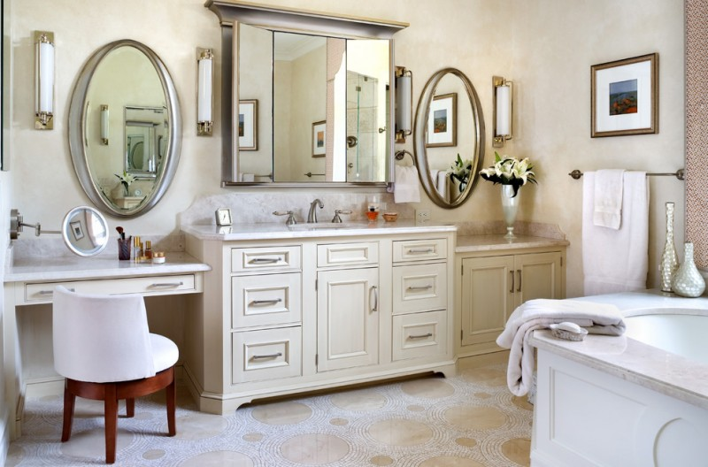 a trendy bathroom with mosaic tile white vanity with white countertop white chair and tub flower vase white artistic bathroom jars
