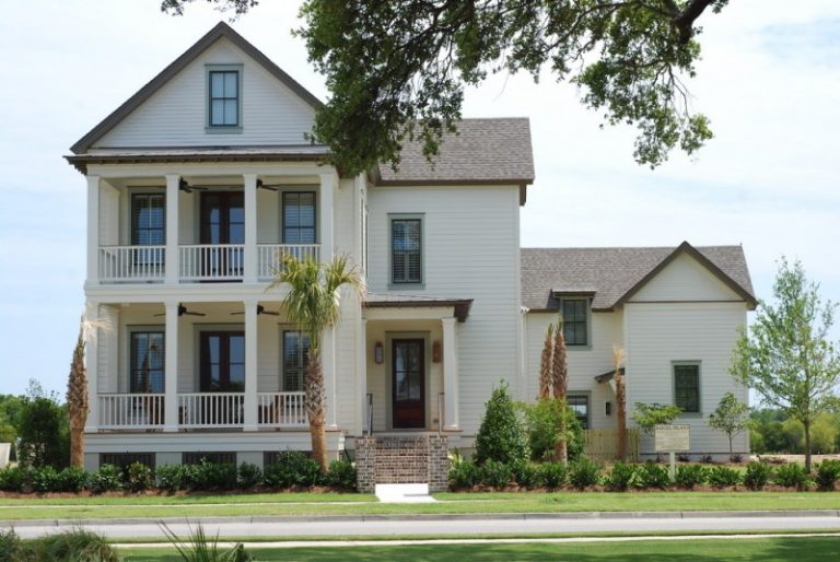 A Two Story Timeless White Painted Deck Wood Exterior Home Wooden Fences Brown Roofs Brick