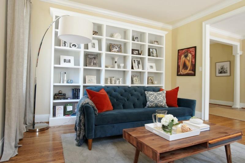 Urban Condo Living Room Interior Design In Philadelphia. Arch Lamp Open  Shelves Bluw Sofa Red Throw Pillow Wooden Coffee Table Grey Area Rug Wooden