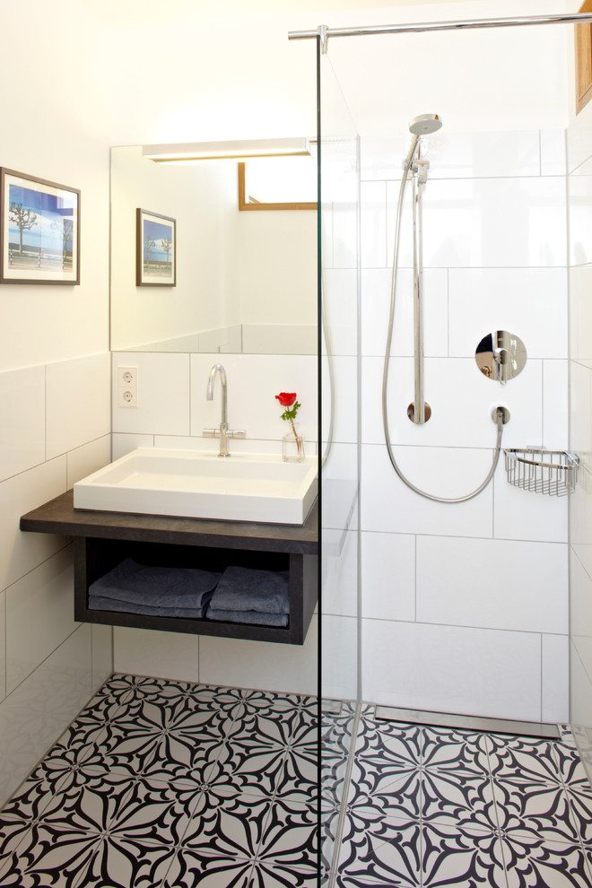 bathroom floor tile ideas beautiful flower patterned floor tile white wall tiles small mirror soap holder square mirror built in wood vanity with a shelf white sink