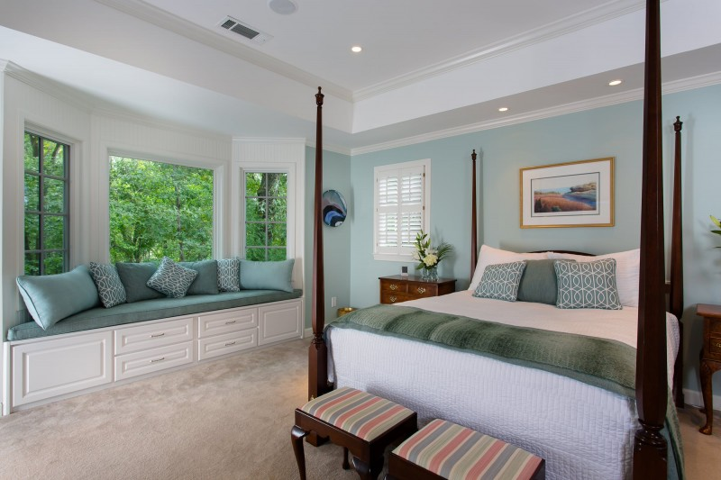 bay window blue trim blue painted wall blue cushion window bench bedding bench storage recessed lights