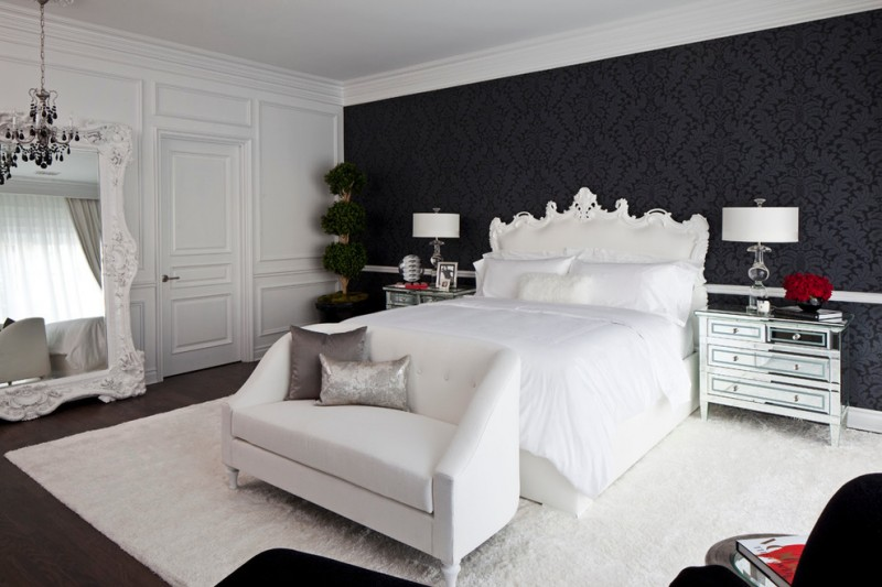 black and white bedroom black patterned wallpaper white bed white side small sofa soft large white rug white framed floor mirror black chandelier