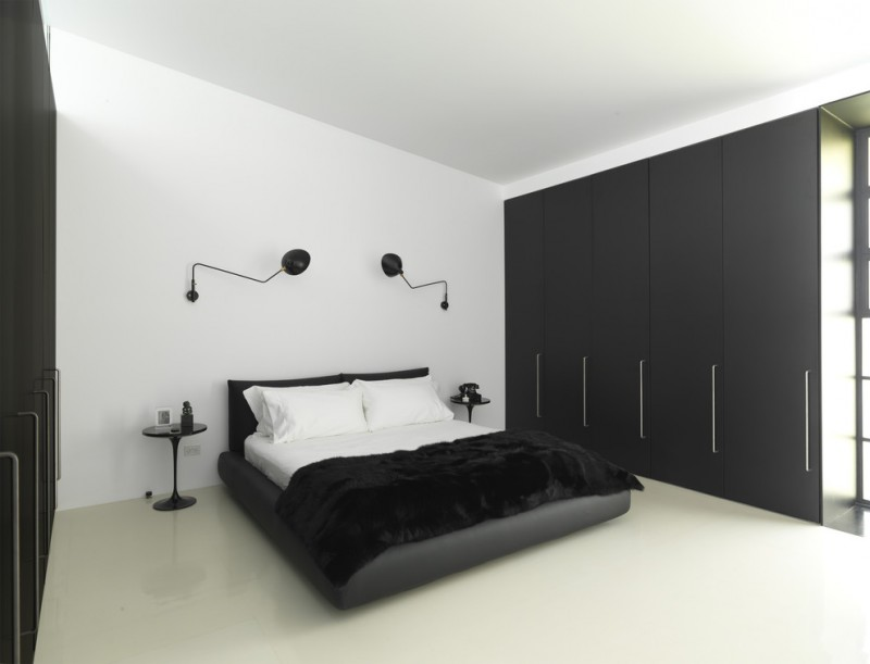black and white bedroom serge mouille 1 curved arm rotating sconce saarinen end table flat black closet black blanket white bed
