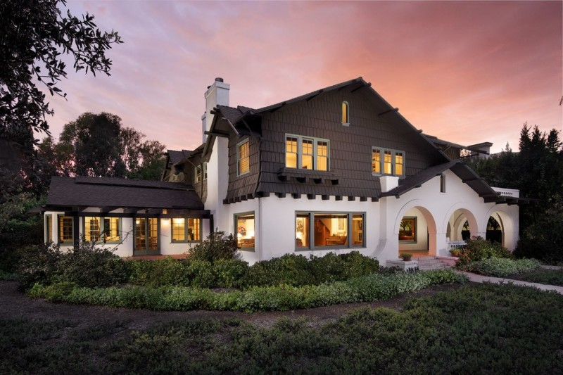 Brown Stucco Two Story Exterior Home With Roman Arches White Wall Brown  Chocolate Gable Roofs Sage